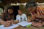 Teacher Lodema Dela Cruz Doroteo helps two women learn to read and write in Santa Ines, an indigenous village in the Philippines. A graduate of Harris Memorial College, where she benefited from a scholarship from United Methodist Women, she is the first indigenous school teacher in her village.