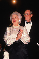United States President-elect George H.W. Bush and his wife, Barbara Bush attend a dinner at the Corcoran Gallery of Art in Washington, D.C. on January 18, 1989.<br /> CAP/MPI/RS<br /> &copy;RS/MPI/Capital Pictures