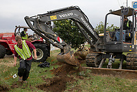 """NWA Democrat-Gazette/CHARLIE KAIJO Tyler Grant of Fayetteville helps plant China Snow Fringetrees on Monday, November 13, 2017 on 14th Street and Tater Black Rd. in Centerton. The city of Centerton contracted the crew Fresh and Green to plant 305 trees throughout the city all the way up to Greenhouse Road. The Wal-Mart Family Foundation awarded the city a grant for $181,000 for the project. """"I think it's going to be very nice for the city and give it a new look,"""" said Centerton Mayor Bill Edwards. The project is about a quarter of the way finished."""