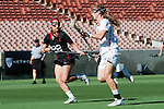 Los Angeles, CA 04/22/16 - Amanda Johansen (USC #7) and Dillon Schoen (Stanford #22) in action during the NCAA Stanford-USC Division 1 women lacrosse game at the Los Angeles Memorial Coliseum.  USC defeated Stanford 10-9/