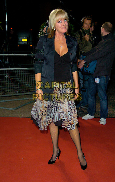 "BEVERLEY CALLARD.Celebrity Guests attend ""Another Audience with Al Murray - Pub Landlord"" at London ITV Studios, South Bank, London, England, October 21st 2007. .full length  Beverly black top jacket grey snakeskin print skirt.CAP/CAN.©Can Nguyen/Capital Pictures"