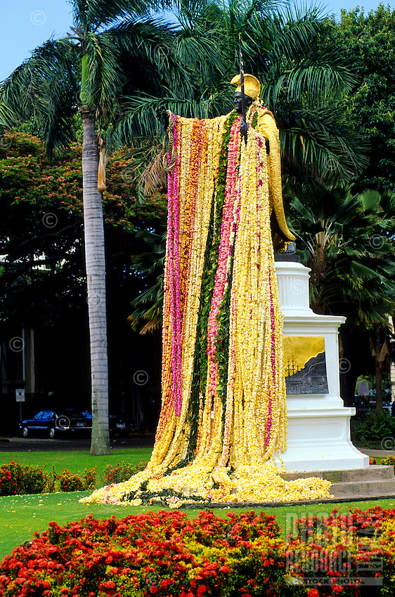 The statue of King Kamehameha draped with lei on King Kamehameha Day, June 11th, downtown Honolulu