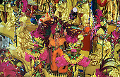 Rio de Janeiro, Brazil. Carnival; Imperatriz samba school procession with gold, purple and orange banana theme.
