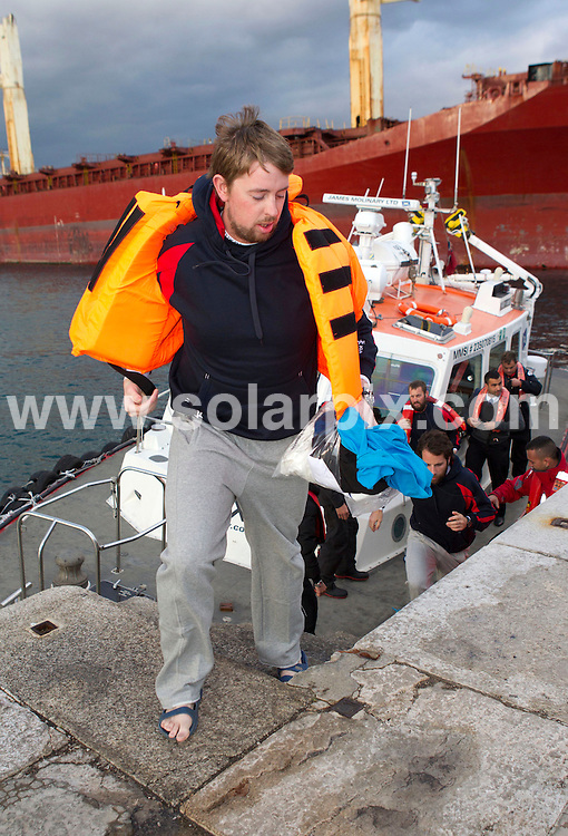 **PICTURES FROM SOLARPIX.COM**                                 **WORLDWIDE SYNDICATION RIGHTS**     .**PICS TO GO WITH WORDS BY GERARD COUZENS-TAG MEDIA**              .Atlantic Odyssey Challenge Team arrive back on shore at the Port of Gibraltar and  this morning after being rescued when their rowing boat capsized during their record attempt to row from Morocco to Barbados in under 30 days. .The six men were picked up 27 days into their journey, from a life raft by a Panamanian-flagged cargo ship..The crew were:.Ian Rowe, 45, from Bedford; Aodhan Kelly, 26, from Dublin; Simon Brown, 37, from Wiltshire, Yaacov Mutnikas, Mark Beaumont, 29, from Perthshire in Scotland, and skipper Matt Craughwell.                                                                                This pic:    Aodhan Kelly followed by Mark Beaumont                                                                                       JOB REF:    14459    AB1       DATE:  09.02.12                                                           **MUST CREDIT SOLARPIX.COM OR DOUBLE FEE WILL BE CHARGED**                                                                        **MUST NOTIFY SOLARPIX OF ONLINE USAGE**                 **CALL US ON: +34 952 811 768 or LOW RATE FROM UK 0844 617 7637**