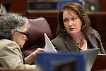 Nevada Assemblywomen Peggy Pierce, D-Las Vegas, left, and April Mastroluca, D-Henderson, talk on the Assembly floor Thursday, May 26, 2011, at the Legislature in Carson City, Nev. .Photo by Cathleen Allison