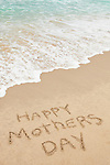 USA, California, Hermosa Beach, Happy mothers day written in sand on beach