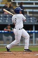 Asheville Tourists designated hitter Wilfredo Rodriguez #3 swings at a pitch during a game against the Greenville Drive at McCormick Field on May 18, 2014 in Asheville, North Carolina. The Tourists defeated the Drive 3-1. (Tony Farlow/Four Seam Images)