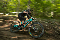 NWA Democrat-Gazette/BEN GOFF @NWABENGOFF<br /> Travis Cedoz races Saturday, Aug. 18, 2018, during the Eureka Springs round of the Arkansas Enduro Series at Lake Leatherwood City Park. The event continues Sunday with stages at the Passion Play trails and an urban downhill leg through downtown Eureka Springs. The fifth and final race of the Arkansas Enduro Series season takes place Sept. 22 at the Coler Mountain Bike Preserve in Bentonville. Enduro is a type of mountain bike race with multiple time trial stages that are mostly downhill and technical. The downhill stages are linked together by untimed transition stages or shuttle buses.