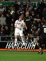 Pictured L-R: Alan Tate of Swansea City against Leon Best.<br />