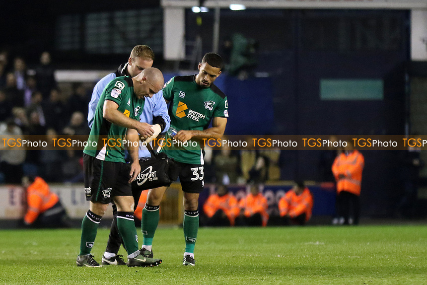Scunthorpe captain, Stephen Dawson, was forced to leave the field in the closing stages with an injury during Millwall vs Scunthorpe United, Sky Bet EFL League 1 Play-Off Football at The Den on 4th May 2017