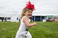 BALTIMORE, MD - MAY 20: A young girl runs around the infield on Preakness Stakes Day at Pimlico Race Course on May 20, 2017 in Baltimore, Maryland.(Photo by Jesse Caris/Eclipse Sportswire/Getty Images)