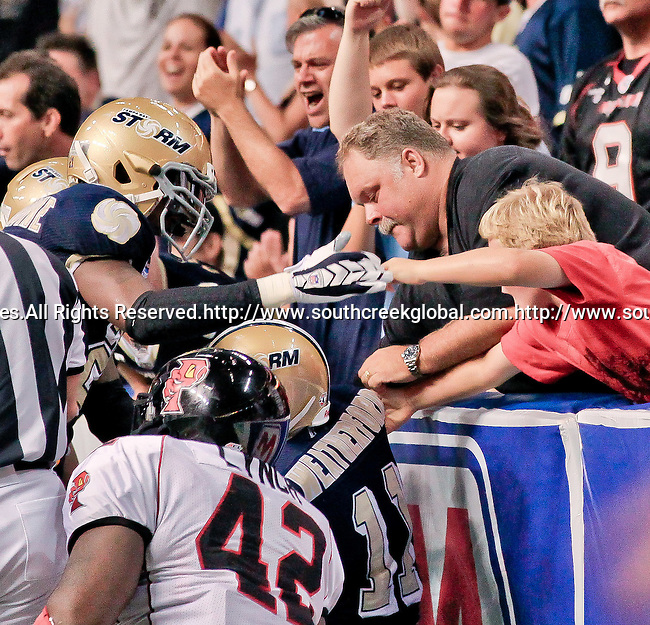 Aug 14, 2010: Tampa Bay Storm defensive back Brandon Hefflin (#17) recovers a surprise on-side kick setting up a Tampa touchdown. The Storm defeated the Predators 63-62 to win the division title at the St. Petersburg Times Forum in Tampa, Florida. (Mandatory Credit:  Margaret Bowles)