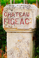 A stone gate post with the inscription Chateau Figeac in the vineyard Saint Emilion Bordeaux Gironde Aquitaine France