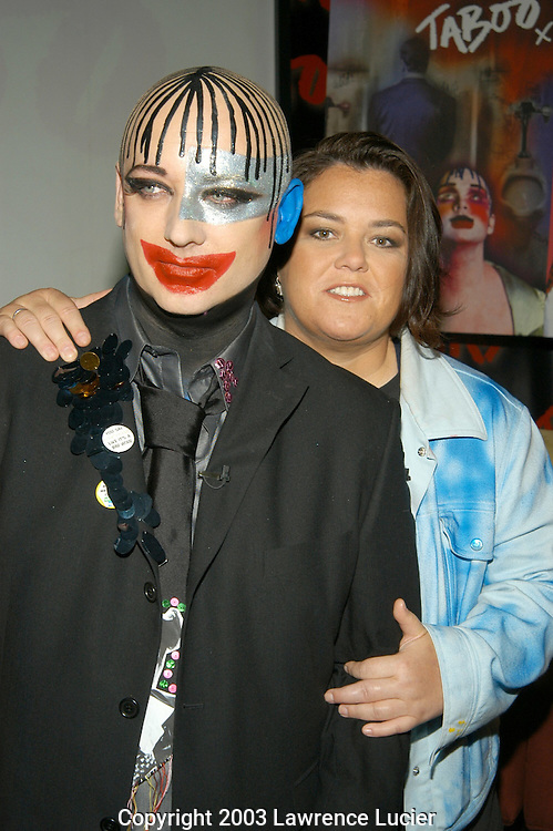 NEW YORK - SEPTEMBER 3: Recording artist Boy George (L) and comedian Rosie O'Donnell arrive at a press conference September 3, 2003, at Cyber Cafe to promote their new musical Taboo. It was the first Broadway press conference broadcast over the Internet.