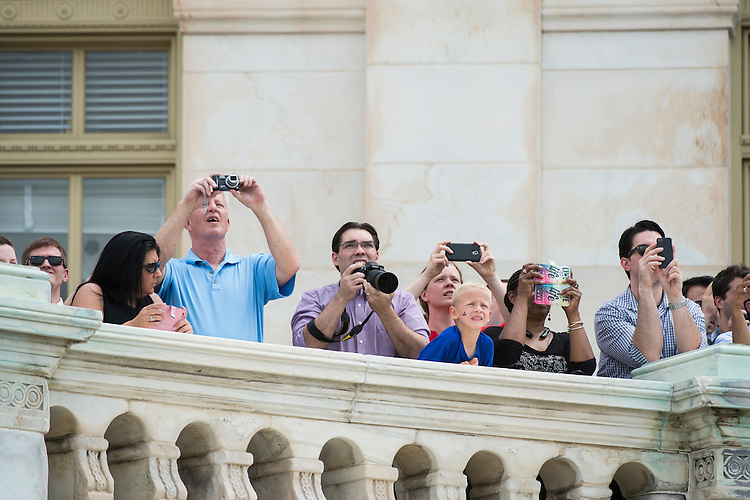 WASHINGTON, DC - MAY 8: The West Front of the U.S. Capitol was crowded with tourists and staff to watch World War II era planes fly past  fly down the National Mall during the Arsenal of Democracy Flyover  the 70th anniversary Victory in Europe celebration on Friday, May 8, 2015. (Photo By Bill Clark/CQ Roll Call)