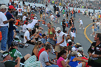 Jul. 5, 2008; Daytona Beach, FL, USA; NASCAR Sprint Cup Series fans congregate in the tri-oval prior to the Coke Zero 400 at Daytona International Speedway. Mandatory Credit: Mark J. Rebilas-