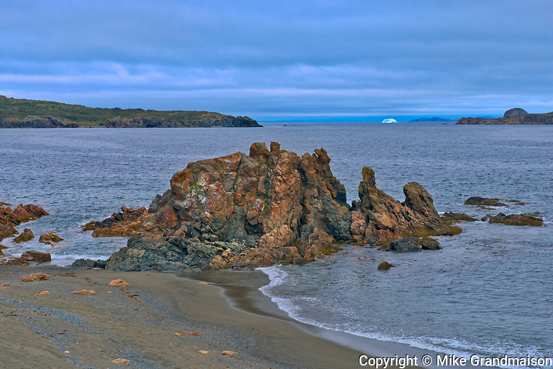 Rocky shorelione on the Bonavista Peninsula at dusk. Atlantic Ocean.<br />