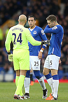 Tim Howard chats with Ramiro Funes Mori and John Stones during the Barclays Premier League match between Everton and Swansea City played at Goodison Park, Liverpool