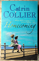 "Pictured: ""Homecoming"" book by Catrin Collier with one of the images Bert Hardy took in Blackpool. Tuesday 01 March 2011<br /> Re: 77 year old Pat Stewart (nee Wilson) who now lives near Llantwit Major in the Vale of Glamorgan, south Wales claims she is one of the two young ladies in an iconic image taken by photographer Bert Hardy at Blackpool Promenade in July 1951, alongside fellow Tiller girl Wendy Clarke. Stewart is alleging that another woman, Norma Edmondson who has been claiming that it is her in the picture, is a fraud.<br /> THE COPYRIGHT OF THE IMAGE ON THE ITEM DEPICTED BELONGS TO BERT HARDY / GETTY IMAGES AND IS ONLY SUPPLIED TO SUPPORT PAT STEWART'S CLAIMS"