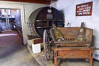 Grenach cask, Un Repas san vins est une journee sans soleil (a meal without wine is like a day without sunshine). Chateau de Nouvelles. Fitou. Languedoc. Barrel cellar. The wine shop and tasting room. France. Europe.