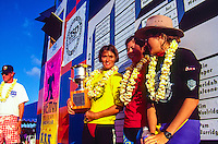 North Shore, Oahu, Hawaii ( December 1993) –  Jodie Cooper (AUS) on the stage after winning the World Cup of Surfing being run at Sunset Beach as part of the Vans Triple Crown of Surfing. Newly crowned World Champion Pauline Menzcer (AUS) was 2nd while Pam Burridge (AUS) was 3rd. Photo: joliphotos.com