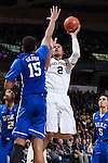 Devin Thomas (2) of the Wake Forest Demon Deacons shoots over Jahlil Okafor (15) of the Duke Blue Devils during second half action at the LJVM Coliseum on January 7, 2015 in Winston-Salem, North Carolina.  The Blue Devils defeated the Demon Deacons 73-65.  (Brian Westerholt/Sports On Film)