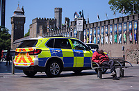 Pictured: An old man sleeps on a bench next to a police car opposite Cardiff Castle Thursday 25 May 2017<br />