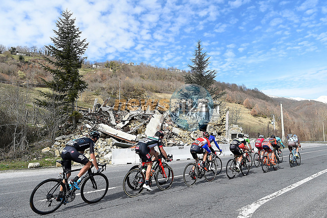 The peloton pass by recent earthquake damage during Stage 5 of the 2017 Tirreno Adriatico running 210km from Rieti to Fermo, Italy. 12th March 2017.<br /> Picture: La Presse/Fabio Ferrari  | Cyclefile<br /> <br /> <br /> All photos usage must carry mandatory copyright credit (&copy; Cyclefile | La Presse)