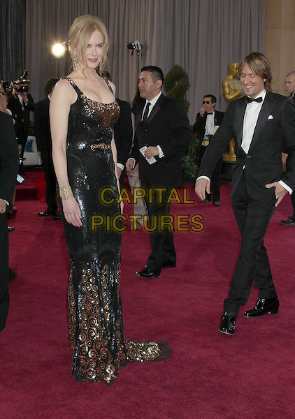 Nicole Kidman (wearing Balenciaga) & Keith Urban.85th Annual Academy Awards held at the Dolby Theatre at Hollywood & Highland Center, Hollywood, California, USA..February 24th, 2013.oscars full length black dress gold sequins sequined sleeveless smiling married husband wife black tuxedo white shirt  .CAP/ADM/RE.©Russ Elliot/AdMedia/Capital Pictures.