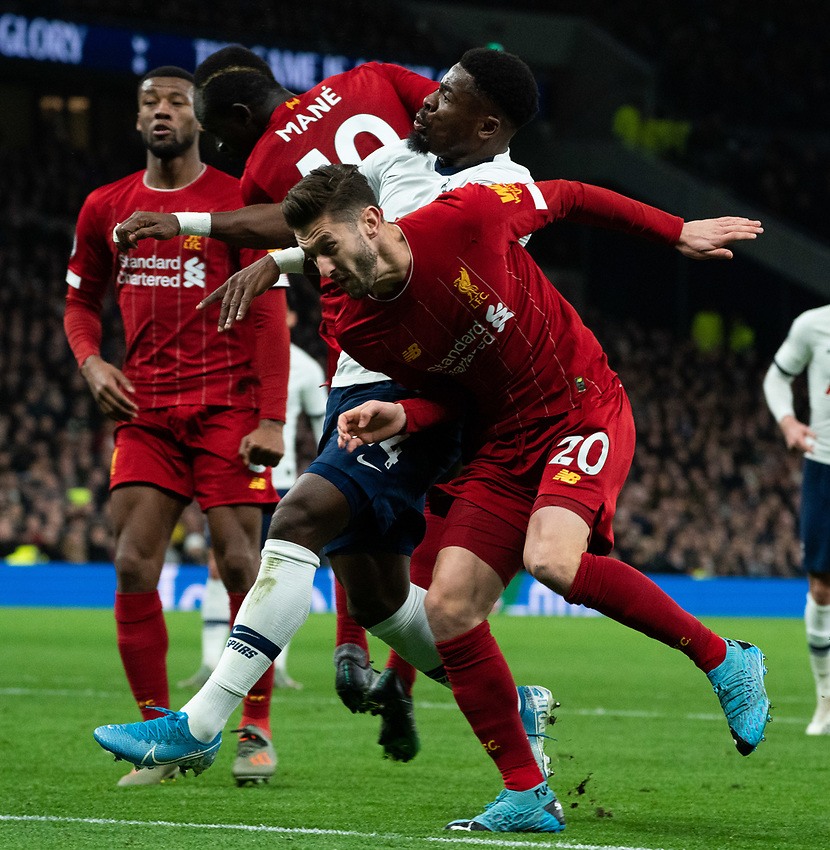 Tottenham's Serge Aurier vies for possession with Liverpool's Adam Lallana and Sadio Mane <br /> <br /> Photographer Stephanie Meek/CameraSport<br /> <br /> The Premier League - Tottenham Hotspur v Liverpool - Saturday 11th January 2020 - Tottenham Hotspur Stadium - London<br /> <br /> World Copyright © 2020 CameraSport. All rights reserved. 43 Linden Ave. Countesthorpe. Leicester. England. LE8 5PG - Tel: +44 (0) 116 277 4147 - admin@camerasport.com - www.camerasport.com