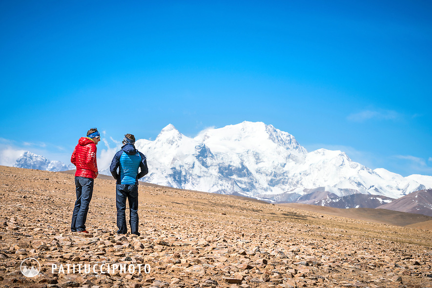 Ueli Steck and David Göttler looking at the north side of Shishapangma from a distance on the Tibetan Plateau during their drive to start their climbing expedition to the 8000 meter peak Shishapangma, Tibet