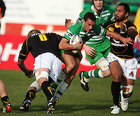 Manawatu first five Aaron Cruden is tackled by Mark Reddish and Serge Lilo during the Air NZ Cup preseason match between Manawatu Turbos and Wellington Lions at FMG Stadium, Palmerston North, New Zealand on Friday, 17 July 2009. Photo: Dave Lintott / lintottphoto.co.nz