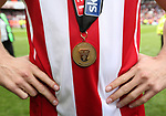 A Sheffield United winners medal during the League One match at Bramall Lane, Sheffield. Picture date: April 30th, 2017. Pic David Klein/Sportimage