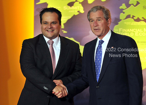 Washington, D.C. - November 15, 2008 -- United States President George W. Bush welcomes Deputy Secretary of Finance Jan Kees de Jager of the Netherlands to the Summit on Financial Markets and the World Economy leaders to the National Building Museum in Washington, D.C. on Saturday, November 15, 2008..Credit: Ron Sachs / Pool via CNP