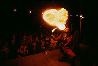 Sideshow trickster Angelo Helay swallows swords and becomes a human pincushion when he isn't breathing fire across the fairgrounds
