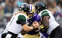 Joe Tryon breaks through to pressure Hawaii quarterback Cole McDonald.