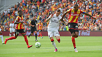 20190803 - LENS , FRANCE : Lens' Steven Fortes (R) and Arial Mendy (L) with Guigamp's Nolan Roux (M) pictured during the soccer match between Racing Club de LENS and En Avant Guingamp , on the second matchday in the French Dominos pizza Ligue 2 at the Stade Bollaert Delelis stadium , Lens . Saturday 3 th August 2019 . PHOTO DIRK VUYLSTEKE | SPORTPIX.BE