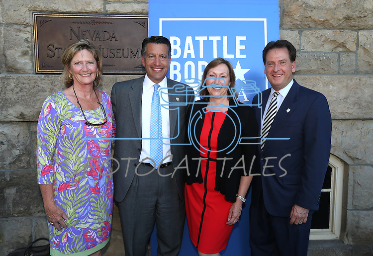From left, Linda, Gov. Brian Sandoval, Pam Robinson and Lt. Gov. Brian Krolicki pose with their medallions from the fourth and final in a commemorative Sesquicentennial series at the Nevada State Museum, in Carson City, Nev., on Wednesday, Sept. 3, 2014. <br /> Photo by Cathleen Allison