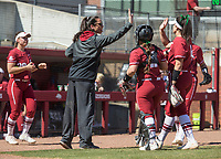 NWA Democrat-Gazette/BEN GOFF @NWABENGOFF<br /> Courtney Deifel, Arkansas head coch, high-fives players after the top of the 5th inning vs South Carolina Sunday, March 17, 2019, at Bogle Park in Fayetteville.