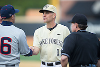 Wake Forest Demon Deacons head coach Tom Walter (16) shakes hands with UConn Huskies head coach Jim Penders (16) prior to the start of their game at Wake Forest Baseball Park on March 17, 2015 in Winston-Salem, North Carolina.  The Demon Deacons defeated the Huskies 6-2.  (Brian Westerholt/Four Seam Images)