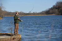 NWA Democrat-Gazette/FLIP PUTTHOFF <br /> Fly fishing is the method of choice for Jared Arthur of Jonesboro, who fished for trout at Lake Atalanta on Saturday Dec. 22 2018.  A woolly bugger is his fly of choice on any trout water. Arthur was visiting family in Northwest Arkansas over Christmas.
