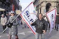Milano, 12/12/2014 - manifestazione per lo sciopero generale nazionale organizzato dai sindacati CGIL e UIL in protesta contro la politica del lavoro del governo Renzi<br /> <br /> Milan, 12/12/2014 - demonstration for the national general strike organized by trade unions CGIL and UIL in protest against the work policy of the government Renzi