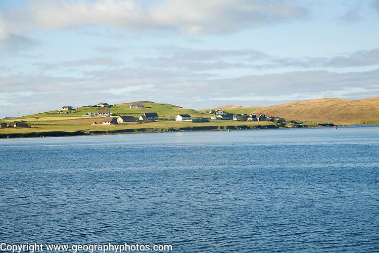 Houses on Trondra island across East Voe of Scalloway, Shetland Islands, Scotland