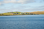 Houses on Trondra island across East Voe of Scalloway, Shetland Islands, Scotland