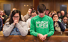 Jan. 22, 2014; Students pray during Mass at St. Agnes Church in Arlington, Virginia before the 2014 March for Life. Photo by Barbara Johnston/University of Notre Dame