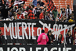 """22 October 2011: DC fans hold up a banner with the """"Glory"""" part of their """"Death or Glory"""" motto crossed out. A comment on the fact that DC United had been eliminated from the postseason before the game. Sporting Kansas City defeated DC United 1-0 at RFK Stadium in Washington, DC in a 2011 regular season Major League Soccer game."""