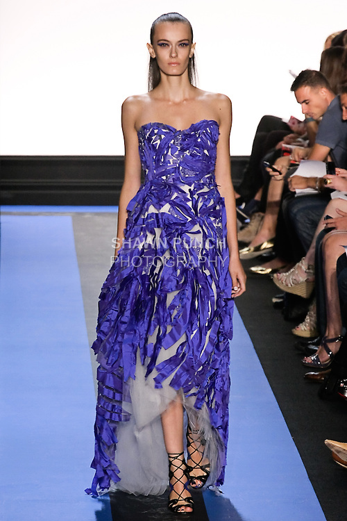 Erjona walks runway in a cobalt blue taffeta strapless corset hi-low gown, by Monique Lhuillier, from the Monique Lhuillier Spring 2012 collection fashion show, during Mercedes-Benz Fashion Week Spring 2012.