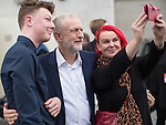 © Joel Goodman - 07973 332324 . 25/09/2016 . Liverpool , UK . Supporters pose for a selfie with JEREMY CORBYN as he leaves the Museum of Liverpool after The Marr Show , during a round of Sunday morning political interviews from the Docks in Liverpool on the first day of the Labour Party Conference . Photo credit : Joel Goodman