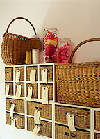 A series of rattan baskets have been used as drawers in a bespoke storage unit