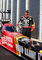 Sep 13, 2013; Charlotte, NC, USA; NHRA top fuel dragster driver Antron Brown poses for a portrait during qualifying for the Carolina Nationals at zMax Dragway. Mandatory Credit: Mark J. Rebilas-